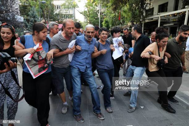 Turkish riot police try to disperse protesters during a demonstration against the arrest of hunger strikers academic Nuriye Gulmen and teacher Semih...