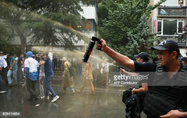 Turkish riot police use tear gas to disperse protesters during a demonstration against the arrest of hunger strikers Nuriye Gulmen and Semih Ozakca...