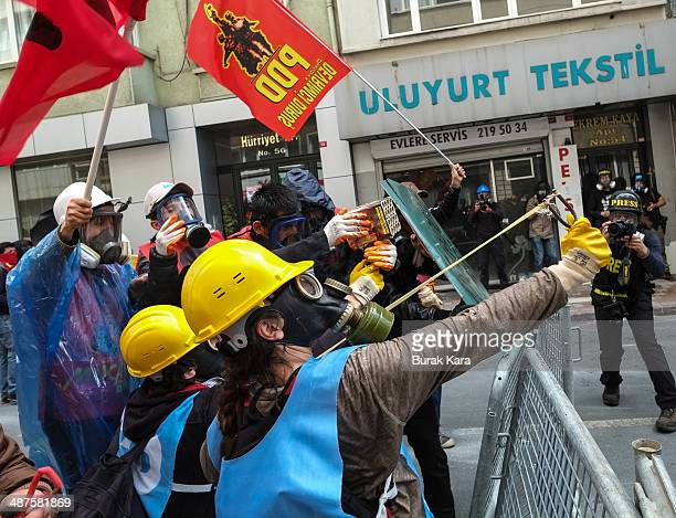 Turkish riot police use water cannon and tear gas to disperse protesters during a May Day demonstration on May 1 2014 in Istanbul Turkey Turkish...