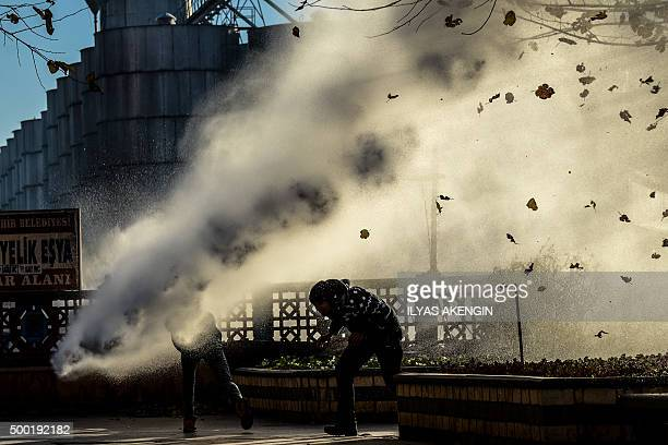TOPSHOT Turkish riot police use water cannon to disperse protestors from Diyarbakir's historical Sur district which has been placed under a curfew on...