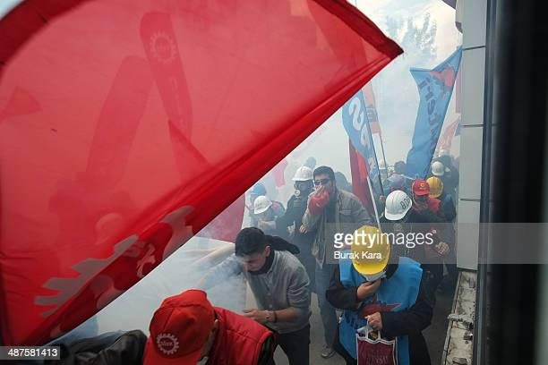 Turkish riot police use water cannons and tear gas to disperse protesters during a May Day demonstration on May 1 2014 in Istanbul Turkey Turkish...