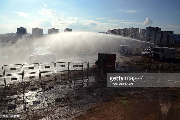 TOPSHOT Turkish riot police use water cannons to disperse fans arround the stadium on February 9 2016 in Diyarbakir southeastern Turkey during the...