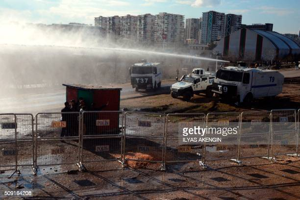 Turkish riot police use water cannons to disperse fans arround the stadium on February 9 2016 in Diyarbakir southeastern Turkey during the Ziraat...