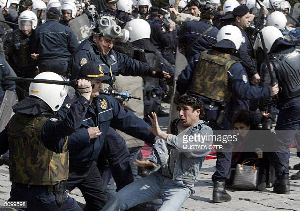 Turkish riot policemen beat demonstrators to disperse them 16 March 2004 in the center downtown Istanbul during the 16th anniversary of the Halabja...