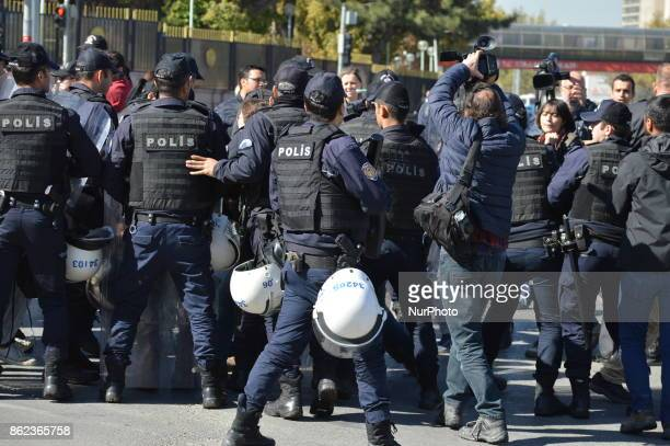 Turkish riot policemen disperse woman protesters who were going to march to the Grand National Assembly of Turkey to protest against the law proposal...
