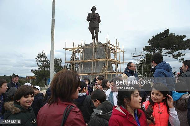 Turkish schoolchildren gather near a statue of Mustafa Kemal, who served as an Ottoman division commander during the Gallipoli campaign and later...