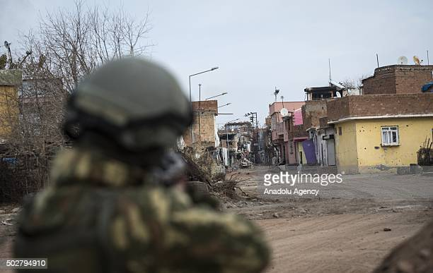 Turkish Security forces member stands guard as troops conduct counterterrorism operation in a neighbourhood under curfew for about a month in Turkeys...