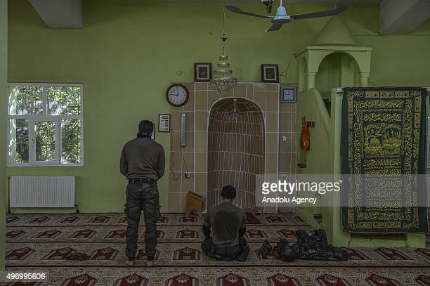 Turkish Security forces members perform a prayer at a mosque after securing it from terrorists during an operation against terrorist organizations in...