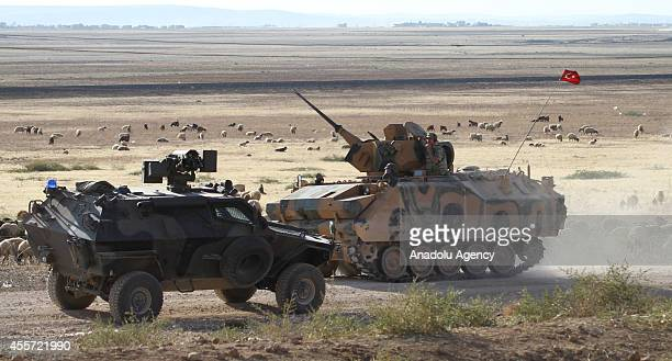 Turkish security forces take security measures on TurkishSyrian border as scores of Syrians fleeing attacks from Islamic State and the Levant in the...