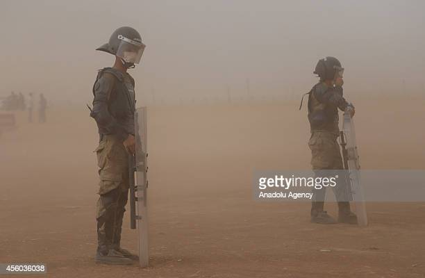 Turkish security forces try to take security measures as a group of Syrian Kurds fled from the clashes between Islamic State of Iraq and the Levant...