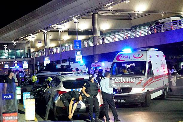 Turkish security officers and ambulances gather outside Turkey's largest airport Istanbul Ataturk after it was hit by a suicide bomb attack on June...