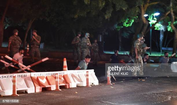 Turkish security officers detain unknown individuals on the side of the road on July 15 2016 in Istanbul during a security shutdown of the Bosphorus...