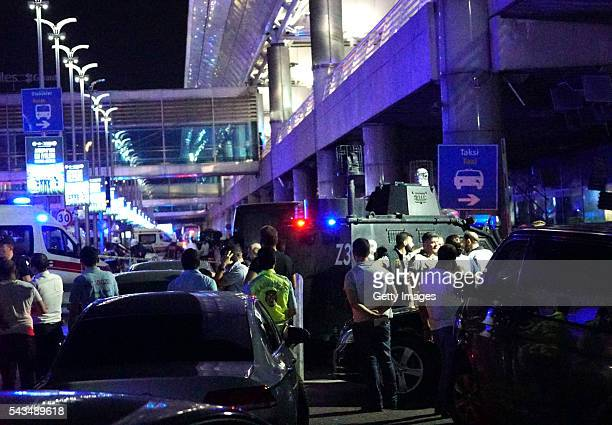 Turkish security officers gather outside Turkey's largest airport Istanbul Ataturk after it was hit by a suicide bomb attack on June 28 Turkey Three...
