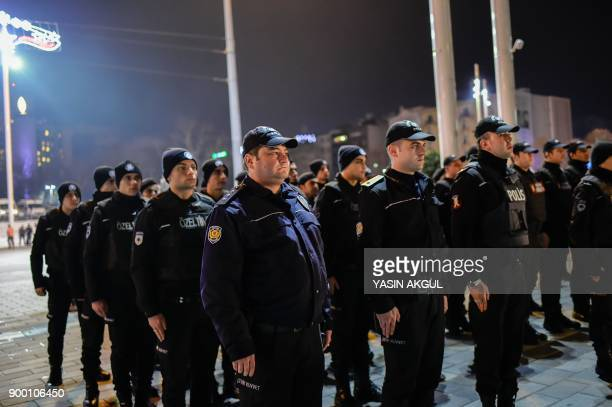 Turkish security officers gather to patrol around the city's main Taksim Square as people remember the victims of a deadly New Year's attack a year...