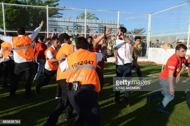 Turkish security officials disperse Amedspor fans on May 16 2017 after Amedspor lost the Turkish Super Lig white group semifinal second leg football...