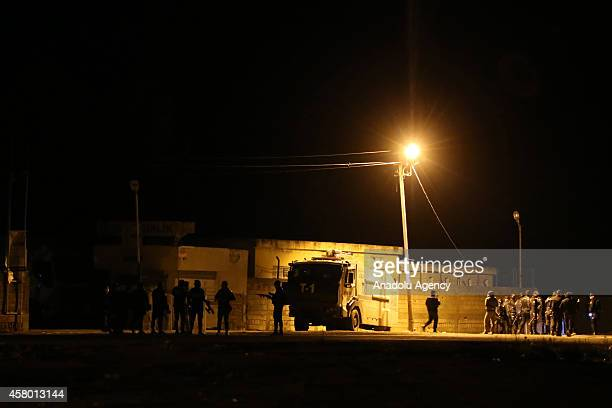 Turkish security officials take extensive security measures as a group of Iraqi Kurdish Peshmerga forces who will travel onwards to the Syrian town...