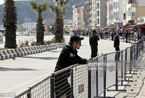 Turkish security stand guard as they close all roads in the the coastal town of Eceabat in Gallipoli peninsula as Turkish President Recep Tayyip...