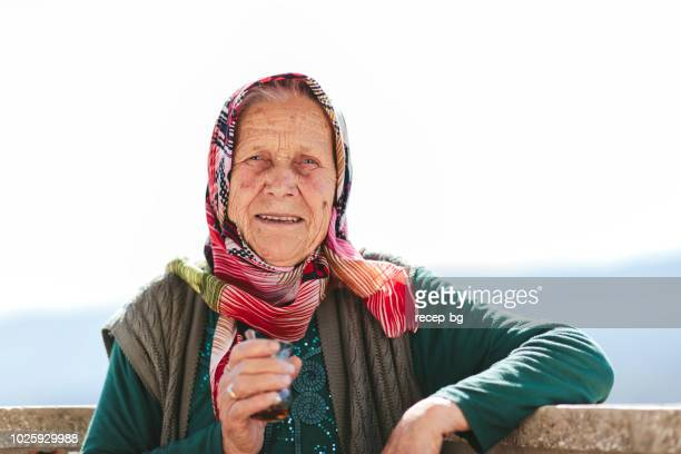 turkish senior woman smiling for camera - middle east stock pictures, royalty-free photos & images
