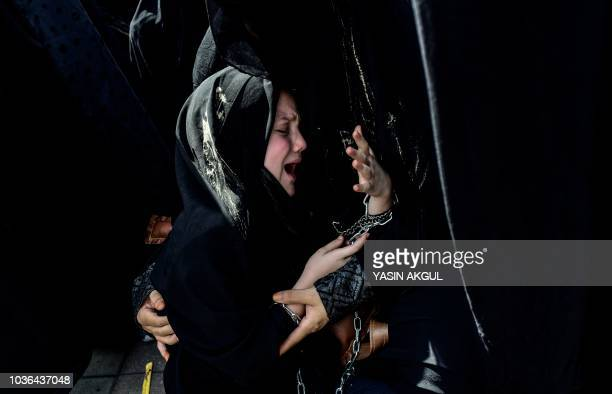 Turkish Shiite girl cries during a religious procession held for the Shiite religious holiday of Ashura on September 20 in Istanbul Ashura...