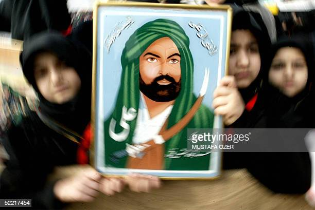 Turkish Shiite girls holds poster of Imam Ali who is son in law of Prophet Mohammed during the mourning of Ashura in Istanbul 19 February 2005 By...