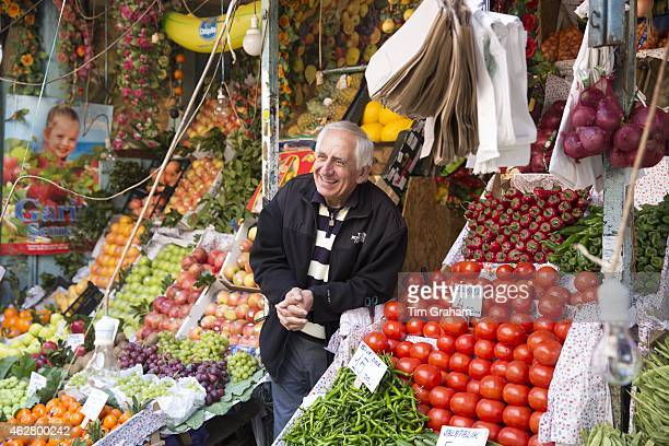 Turkish shopkeeper selling fresh vegetables on sale at food and spice market in Kadikoy district Asian side of Istanbul Turkey#13#10