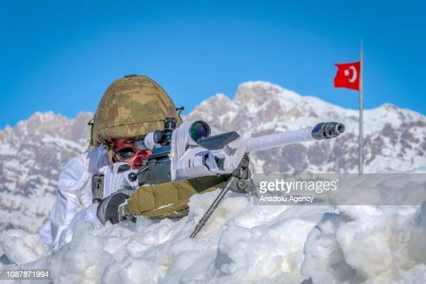 Turkish soldier aims his gun during an operation at a mountainside during winter near TurkeyIraq border in Daglica village of Yuksekova district of...