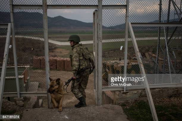 Turkish soldier from the 1st Border Regiment Command takes part in an alert drill scenario at a military outpost on the Turkey/Syria border on March...