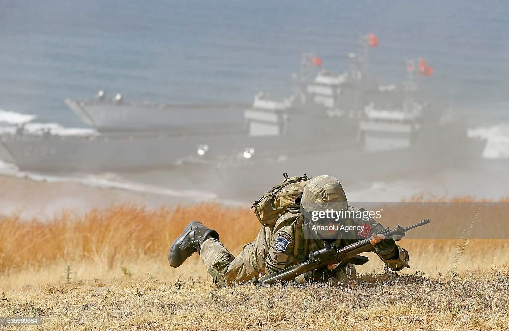 A Turkish soldier is seen during the Efes-2016 Combined Joint Live Fire Exercise at Seferihisar district of Izmir, Turkey on May 31, 2016. The Turkish-led multinational military exercises, Efes-2016 which started at 04 May and will be finished at 04 June 2016, aims to train participating units and staff in planning and conducting combined and joint operations, including logistics and command-control as well as to improve the level of interoperability among headquarters and forces.