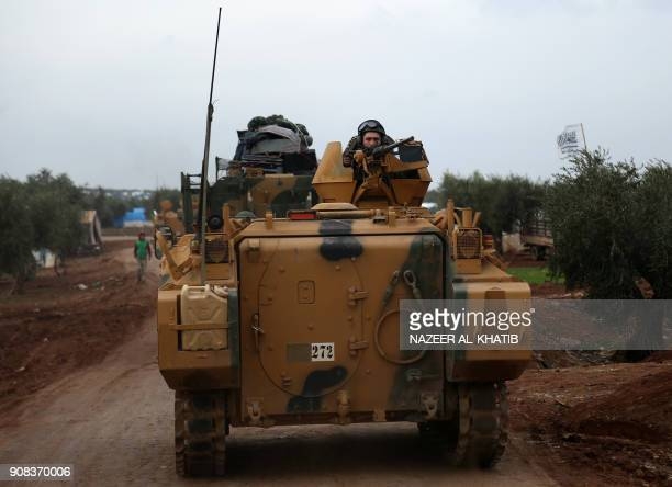 A Turkish soldier mans a turret on an infantry fighting vehicle driving near the village of Yazi Bagh about six kilometres from the Bab alSalamah...