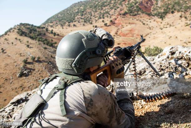 turkish soldier shooting with machine gun - machine gun stock pictures, royalty-free photos & images