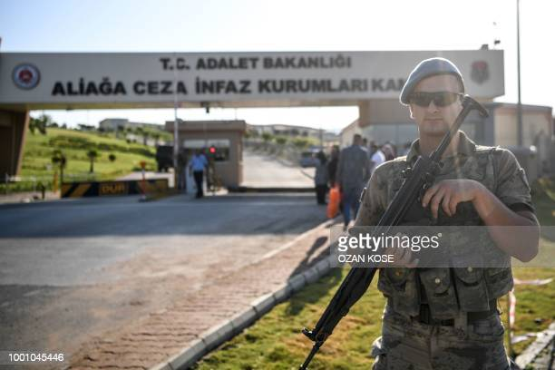 A Turkish soldier stands guard at the entrance of the Aliaga court and prison complex during the trial of US pastor Andrew Brunson held on charges of...