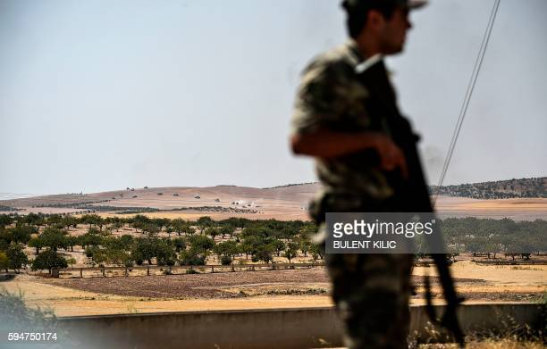 Turkish soldier stands guard in the Turkish Syrian border city of Karkamis in the southern region of Gaziantep on August 24 2016 as Turkish army...