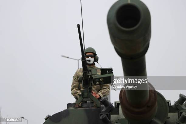 Turkish soldier wears mask at a armoured vehicle within precautions against coronavirus pandemic at 66th Mechanised Infantry Brigade Command in Corlu...