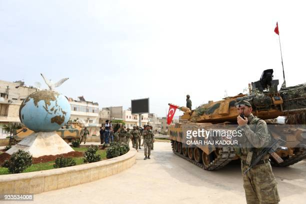 Turkish soldiers and Ankarabacked Syrian Arab fighters spread in the Kurdishmajority city of Afrin in northwestern Syria after seizing control of it...