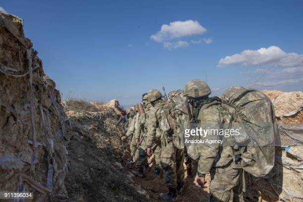 Turkish soldiers are seen after Turkish military aircrafts hit PYD/PKK terror group targets and secure the mountain within the 'Operation Olive...