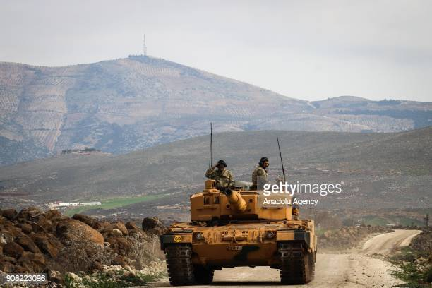 Turkish soldiers are seen on a tank as it is being transported to Hatay Turkey as part of the 'Operation Olive Branch' on January 21 2018 The...