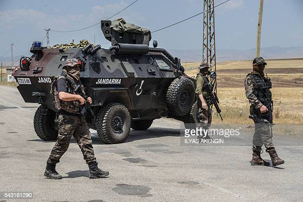Turkish soldiers block the road at a military check point as Members of Parliament of the proKurdish Peoples' Democratic Party and kurdish activists...