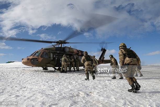 Turkish soldiers board a military helicopter with its engine running in Hakkari Turkey on December 30 2016 Turkish Armed Forces frequently conduct...