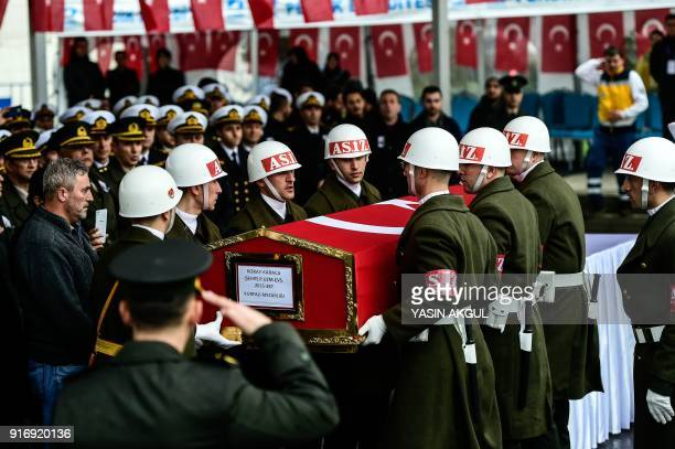Turkish soldiers carry the coffin of Koray Karaca a Turkish soldier who was killed in crossborder clashes with Kurdish People's Protection Units...