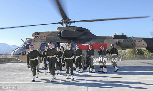 Turkish soldiers carry the coffins of 3 soldiers who were martyred in a terrorist attack in Cizre district of Sirnak to helicopter during a funeral...