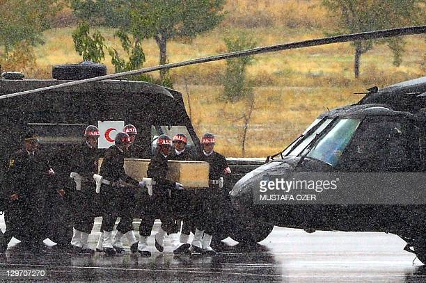 Turkish soldiers carry the coffins of soldiers who were killed in an attack by members of the Kurdistan Workers' Party during funerals in Van on...