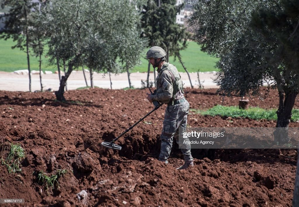 Turkish soldiers conduct search works for explosive ordnances, including improvised explosive devices and mines with a sniffer dog named as leylak after Turkish Armed Forces and Free Syrian Army (FSA) took complete control of northwestern Syria's Afrin within the 'Operation Olive Branch', on March 26, 2018. After the Turkish military and Free Syrian Army liberated the Afrin town center from YPG/PKK and Daesh terrorists, fresh aerial footage showed that the civilians and buildings there remained unharmed. The Turkish troops and Free Syrian Army fighters took control of the Afrin town center on March 18, 2018 as part of Operation Olive Branch, which was launched on Jan. 20 to clear the area of YPG/PKK-Daesh terrorists.