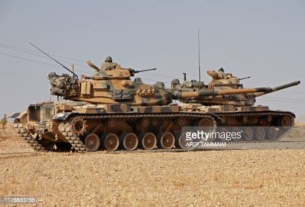 Turkish soldiers drive Americanmade M60 tanks in the town of Tukhar north of Syria's northern city of Manbij on October 14 as Turkey and its allies...