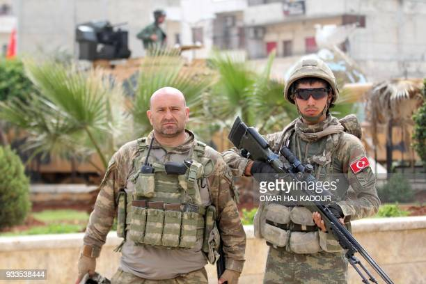 Turkish soldiers gather in the Kurdishmajority city of Afrin in northwestern Syria after seizing control of it from Kurdish People's Protection Units...