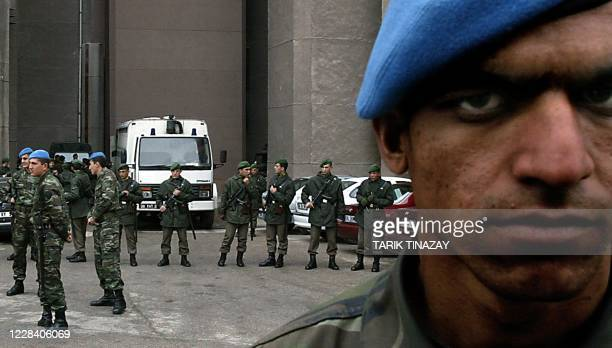 Turkish soldiers guard the Ankara National Security Court, 02 April 2004 as the court prepared to hand down its verdict today in the retrial of human...