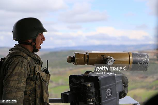 Turkish soldiers keep watch on the Turkey Syria border as Turkish authorities build 35 kilometres long 3 metres high and 7 tones weighted concrete...