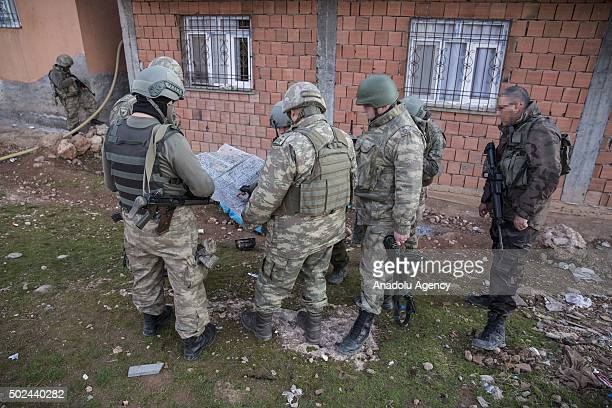 Turkish soldiers look at a map as they carry out an anti terror operation against terrorist organization PKK in Sirnak's Silopi district Turkey on...