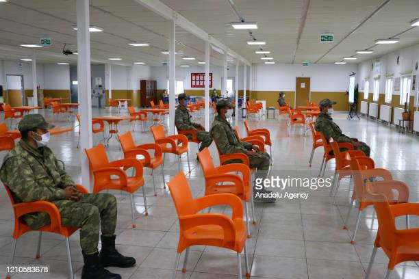 Turkish soldiers maintain social distancing as they spend time at canteen within precautions against coronavirus pandemic at 66th Mechanised Infantry...