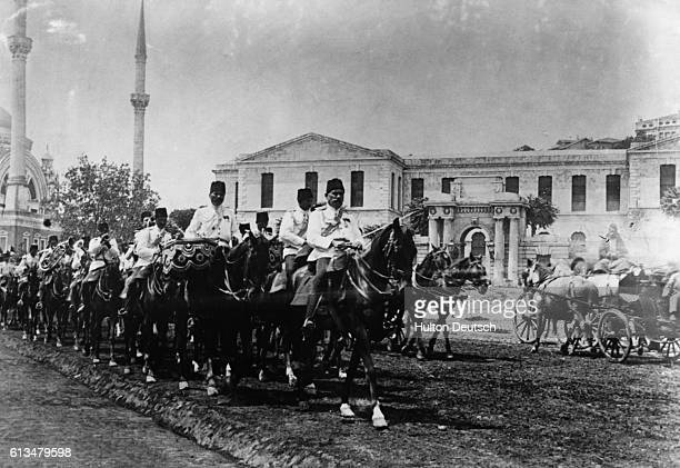Turkish soldiers on horseback march down the streets of Constantinople to defend Libya part of the Ottoman Empire against the invading Italians in...