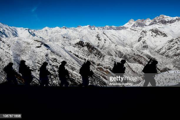 Turkish soldiers patrol at a mountainside during winter near TurkeyIraq border in Daglica village of Yuksekova district of Hakkari Turkey on January...